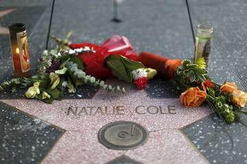 Flowers and candles adorn the star of late singer Natalie Cole on the Hollywood Walk of Fame in Los Angeles