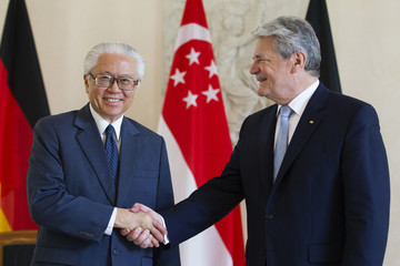 German President Gauck and Singapore's President Tony Tan shake hands before talks at Bellevue Castle in Berlin