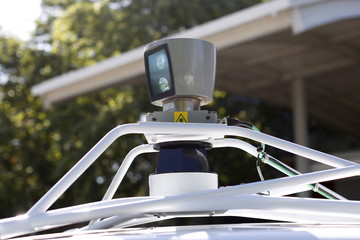 File photo of a sensor spinning atop a Google self-driving vehicle before a presentation at the Computer History Museum in Mountain View, California