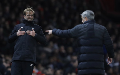 Liverpool manager Juergen Klopp reacts as Manchester United manager Jose Mourinho looks on