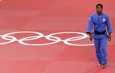 Netherlands' Dex Elmont leaves mat after losing to Japan's Riki Nakaya in men's -73kg semi-final judo match at London 2012 Olympic Games
