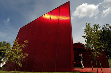 A photographer takes a picture of French architect Jean Nouvel's Serpentine Gallery Pavillion 2010
