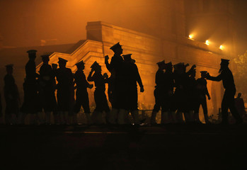 Indian soldiers are silhouetted as they rehearse for the Republic Day parade on a cold winter morning in New Delhi
