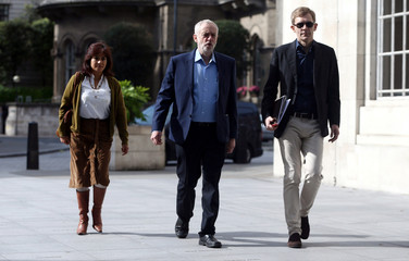 Britain's opposition Labour Party Leader Jeremy Corbyn and his wife Laura Alvarez arrive at a BBC studio in London