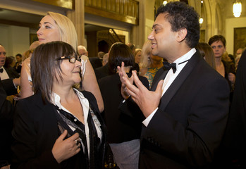 Nominated British authors Smith and Mukherjee talk before the awards dinner for the 2014 Man Booker Prize at the Guildhall in London