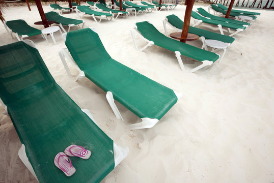 A pair of slippers is seen on a beach chair in Cancun