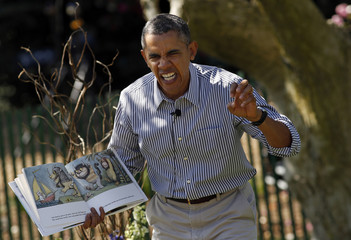 "Obama acts out the line ""gnashed their terrible teeth"" from the children's book ""Where the Wild Things Are"" during the 136th annual Easter Egg Roll on the South Lawn of the White House in Washington"