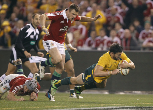 Australia Wallabies' Adam Ashley-Cooper dives across the line to score a try during their rugby union test match against the British and Irish Lions in Melbourne
