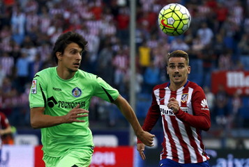 Atletico Madrid's Griezmann and Getafe's Vergini fight for the ball during their Spanish first division soccer match in Madrid