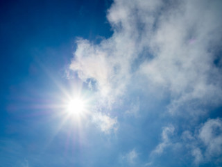 Sun light with blue sky and clouds