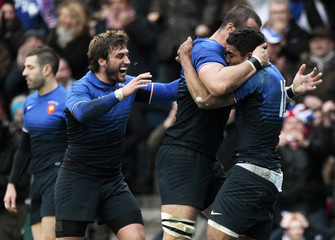 France's Fofana celebrates with his teammates after scoring a try against Scotland in Edinburgh