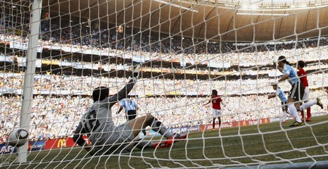 Goalkeeper Jung Sung-ryong fails to save a goal during the 2010 World Cup Group B soccer match against Argentina at Soccer City stadium in Johannesburg