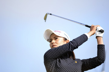 Ai Miyazato of Japan plays her tee shot at the 12th hole during the women's British Open golf tournament at Royal Birkdale Golf Club in Southport