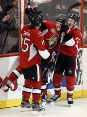 Ottawa Senators' Smith and Neil celebrate Foligno's open-net goal against the Philadelphia Flyers in Ottawa