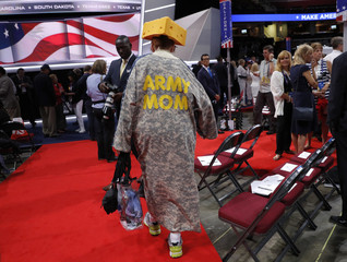 Delegate walks across the convention floor before the start of the final session of the Republican National Convention in Cleveland