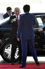 Russian President Vladimir Putin meets Japanese Prime Minister Shinzo Abe in Tokyo