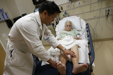 Patient Bush receives treatment from Doctor Leon Yeh in the Emergency Room at OSF Saint Francis Medical Center in Peoria