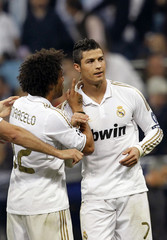 Real Madrid's Ronaldo is congratulated by teammate Marcelo after scoring a goal against CSKA Moscow in Madrid