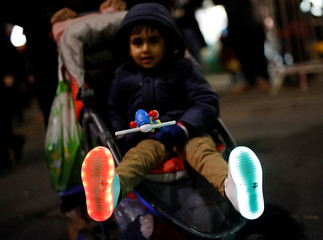A boys shows his illuminated shoes during Diwali celebrations in Leicester