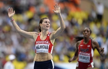 Hejnova celebrates winning the women's 400 meters hurdles final during the IAAF World Athletics Championships in Moscow