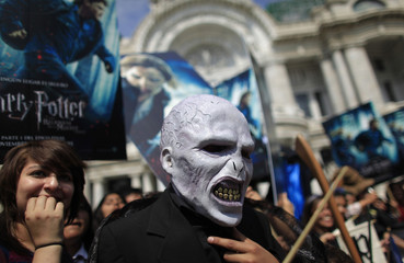A Mexican dressed as Voldemort, a character in the Harry Potter books and movies, gathers with other fans in front of Bellas Artes Palace in Mexico City