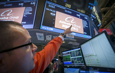 """Specialist Trader Neil Gallagher points to the ticker symbol """"BABA"""" for Alibaba during its IPO at the NYSE in New York"""