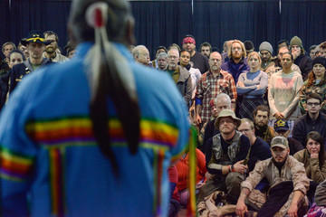 "Veterans listen to Ivan Looking Horse during a healing ceremony hosted by the Standing Rock Sioux tribe as ""water protectors"" continue to demonstrate against plans to pass the Dakota Access pipeline near the Standing Rock Indian Reservation, in Fort Yates"