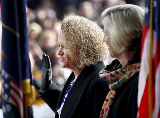 Jackie Biskupski is sworn in as mayor as her finance Betty Iverson watches at Salt Lake City