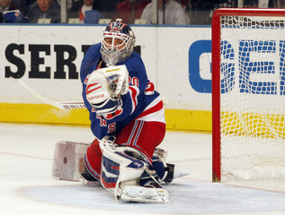 New York Rangers goaltender Henrik Lundqvist makes a glove save during the first period against the New Jersey Devils in Game 1 of the NHL Eastern Conference Finals hockey playoffs at Madison Square Garden in New York