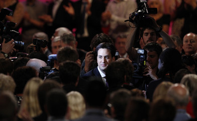 Britain's Labour Party's new leader Ed Miliband walks out of the hall after making his first speech as party leader at the annual conference in Manchester, northern England