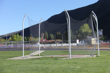 discus pad with football field in background