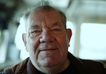 Retired skipper Dennis Avery poses for a photograph in the wheelhouse of his former trawler the Ross Tiger, now on display at the Fishing Heritage Centre in Grimsby, Britain