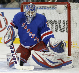 New York Rangers Henrik Lundqvist gloves shot by Pittsburgh Penguins Sidney Crosby in NHL game in New York