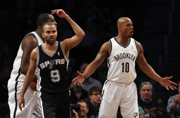 San Antonio Spurs point guard Parker and Brooklyn Nets small forward Bogans react to a call in the second quarter of their NBA basketball game in New York