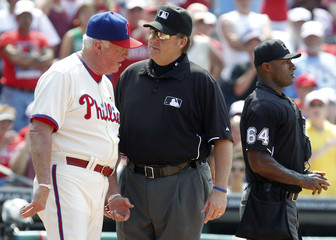 Phillies manager Manuel continues to argue with umpire Cederstrom after being ejected by umpire Porter during the sixth inning of their National League MLB baseball game against the Cubs in Philadelphia