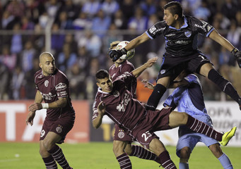 Bolivia's Bolivar goalkeeper Romel Quinonez battles for the ball against Argentina's Lanus Santiago Silva, Carlos Izquierdoz and Oscar Benitez in La Paz