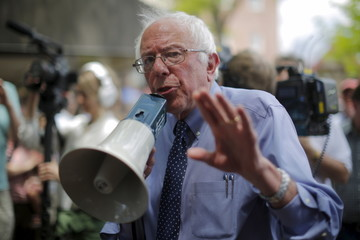 Democratic presidential candidate and U.S. Senator Sanders uses a bullhorn to speak to supporters gathered outside a town-hall campaign stop in Concord