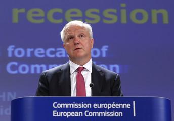 European Economic and Monetary Affairs Commissioner Rehn presents the EU Commission's interim economic forecast in Brussels