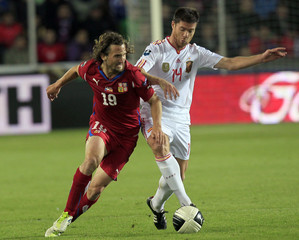 Jiracek of the Czech Republic challenges Alonso of Spain during their Euro 2012 Group I qualifying soccer match in Prague