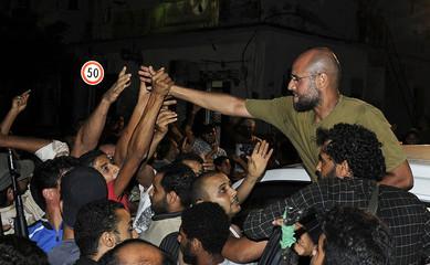 Saif Al-Islam, son of Muammar Gaddafi, greets supporters in Tripoli