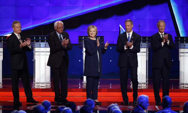 Democratic U.S. presidential candidates e applaud after singer Sheryl Crow sang the U.S. National Antthem before the first official Democratic candidates debate of the 2016 presidential campaign in Las Vegas