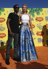 Actor Chris Rock and rapper Iggy Azalea arrive at the 2015 Kids' Choice Awards in Los Angeles