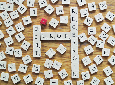 The words debt, recession and Europe, made from letters of a scrabble game, are seen in this illustration picture taken in Ljubljana
