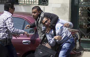 An Egyptian plainclothes policeman detains a student during a protest against the military and interior ministry in front of the faculty of Oral & Dental Medicine in Cairo University