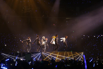 "Members of South Korean K-pop band Super Junior perform during their concert ""Super Show 5""  in Shanghai"