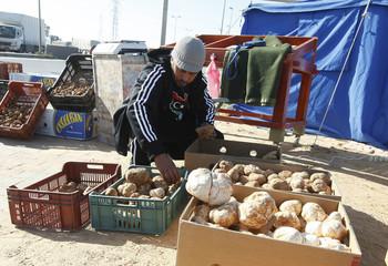 A man sells desert truffles, called Terfas, in Tripoli