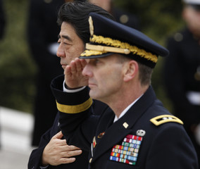 Japanese Prime Minister Shinzo Abe lays a wreath at Arlington National Cemetery in Virginia
