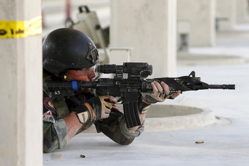 An Afghan soldier competes in the 7th Annual Warrior Competition in Amman