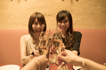 Four people are drinking with champagne