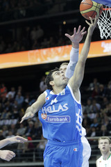 Sloukas of Greece is challenged by Javtokas of Lithuania during their FIBA EuroBasket 2011 basketball game in Kaunas